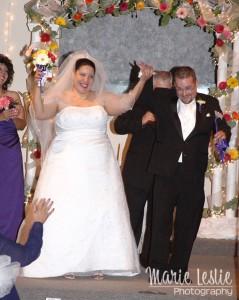 bride and groom leaving altar