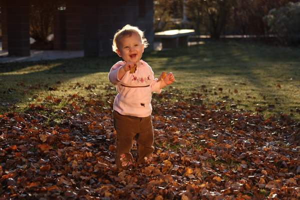 baby and autumn leaves